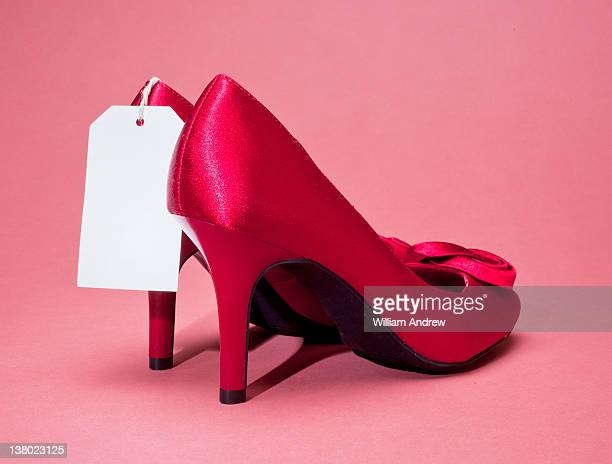 Red high heels with price tag
