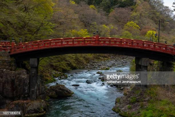 red historic bridge at nikko , the famous travel destination of cultured trip - 栃木県 ストックフォトと画像