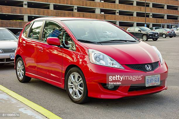 red honda fit - compact car stock photos and pictures