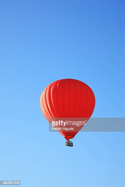 Red Hot Air Balloon in Blue Sky