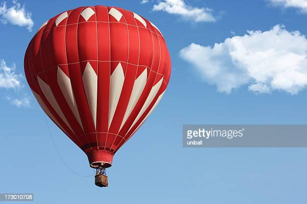 レッドの熱気球、青色背景