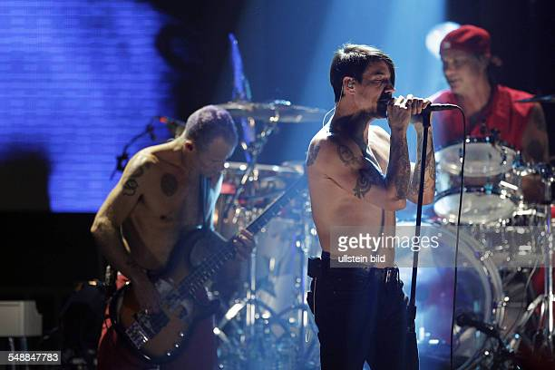 Red Hot Chili Peppers Band Rock music USA Singer Anthony Kiedis Bassist Michael Balzary and Drummer Chad Smith performing in Cologne Germany EWerk