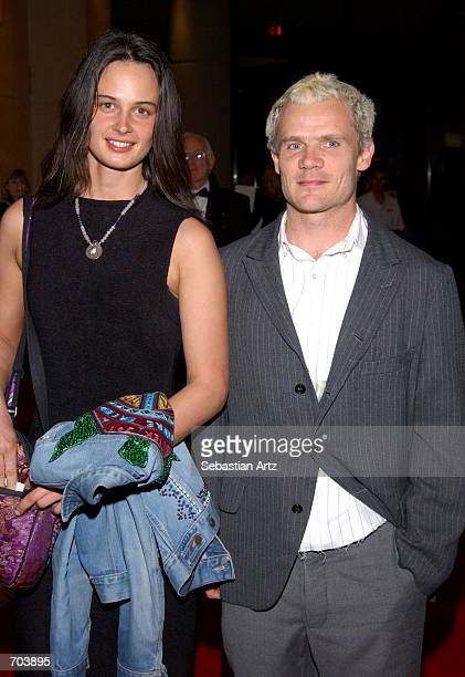 Red Hot Chili Peppers bassist Flea and date attend the 16th Annual Genesis Awards at The Beverly Hilton Hotel March 16 2002 in Beverly Hills CA