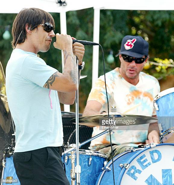 Red Hot Chili Peppers drummer Chad Smith and singer Anthony Kiedis do a sound check at an apartment complex pool as part of VH1's Backyard Barbecue...