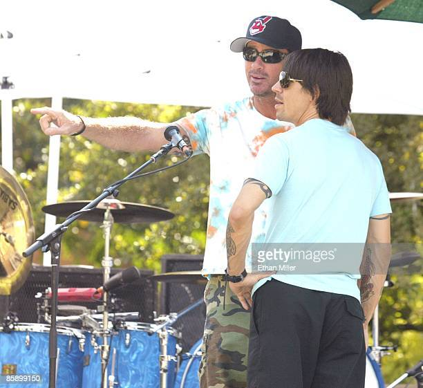 Red Hot Chili Peppers drummer Chad Smith and singer Anthony Kiedis talk during a sound check at an apartment complex pool as part of VH1's Backyard...