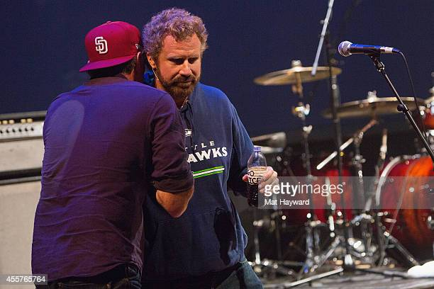 Red Hot Chili Peppers drummer Chad Smith hugs actor and comedian Will Ferrell on stage during 90 Minutes With Will Ferrell benefitting Cancer For...