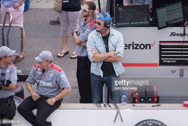 Red Hot Chili Peppers drummer Chad Smith in the pit box of Will Power during the fourth day of practice for the 101st Indianapolis on May 18 at the...