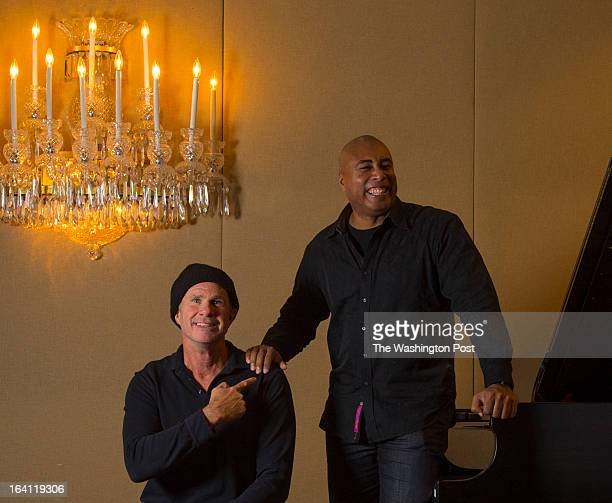 Red Hot Chili Peppers drummer Chad Smith left and New York Yankeeturnedjazz guitarist Bernie Williams pose for a portrait at the Kennedy Center for...