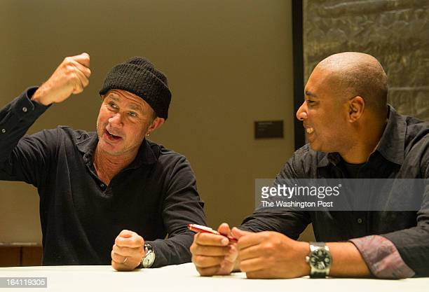 Red Hot Chili Peppers drummer Chad Smith left gestures as New York Yankeeturnedjazz guitarist Bernie Williams looks on during an interview at the...