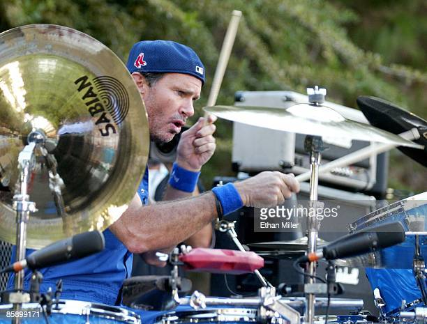Red Hot Chili Peppers drummer Chad Smith performs at an apartment complex pool as part of VH1's 'Backyard Barbecue' contest August 3 2002 in Las...