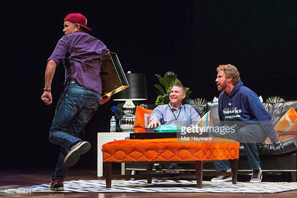 Red Hot Chili Peppers drummer Chad Smith steals the golden cowbell award on stage as Craig Pollard and actor Will Ferrell watch during 90 Minutes...