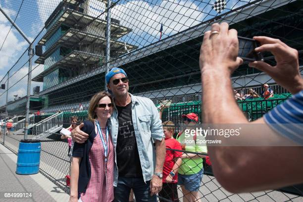 Red Hot Chili Peppers drummer Chad Smith taking photos with fans on the fourth day of practice for the 101st Indianapolis on May 18 at the...