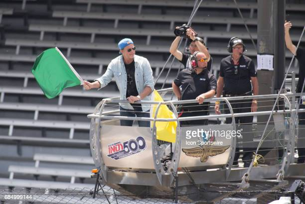 Red Hot Chili Peppers drummer Chad Smith waving the green flag on the fourth day of practice for the 101st Indianapolis on May 18 at the Indianapolis...