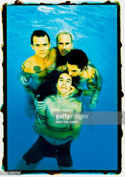 Red Hot Chili Peppers, portrait, posed in a swimming pool, Sunset Marquee, Los Angeles, CA, 18th August 1995.