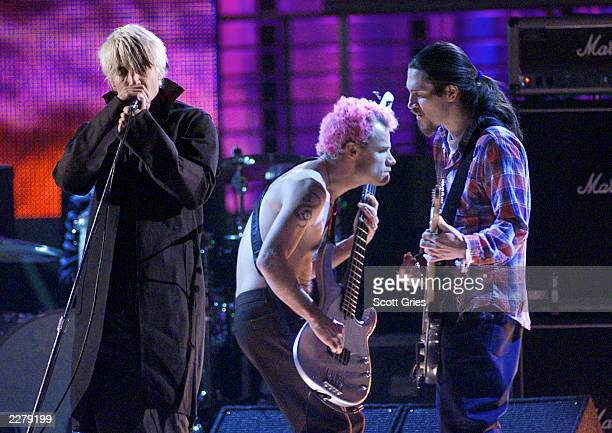 Red Hot Chili Peppers singer Anthony Kiedis bassist Flea and guitarist John Frusciante on the 1999 Billboard Music Awards at the MGM Grand Garden...