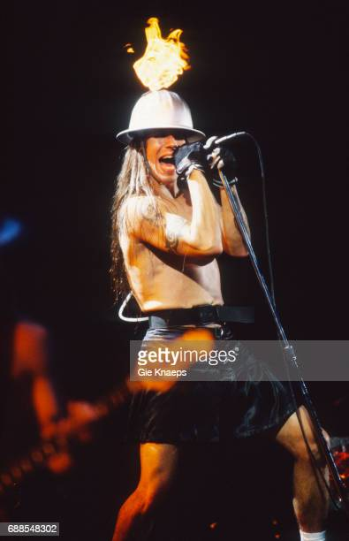 Red Hot Chili Peppers with fire helmets Anthony Kiedis wearing a skirt Pukkelpop Festival Hasselt Belgium