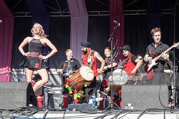 red hot chilli pipers, dancers, dhol foundation, glasgow mela - traditional musician stock photos and pictures