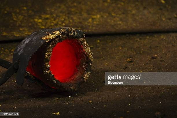 A red hot crucible cools during the casting of bullion at the Rand Refinery Ltd plant in Germiston South Africa on Wednesday Aug 16 2017 Established...
