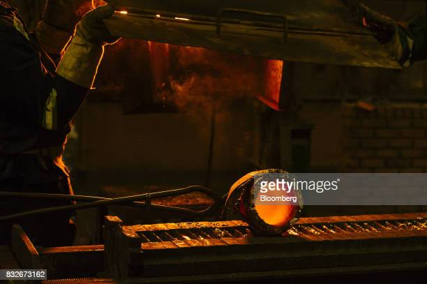 A red hot crucible sits on a mould during the refining of bullion at the Rand Refinery Ltd plant in Germiston South Africa on Wednesday Aug 16 2017...