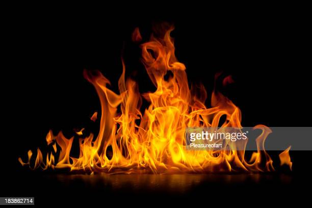 red hot flames of fire isolated on black - fire natural phenomenon stock pictures, royalty-free photos & images