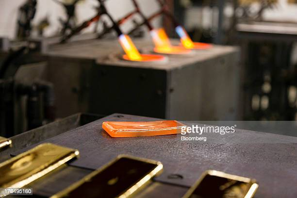 A red hot gold bar cools after being removed from its mould after refining at the Kaloti Jewellery LLC factory in Sharjah United Arab Emirates on...