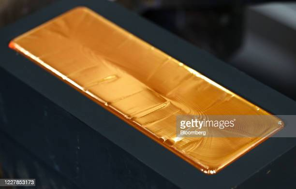 Red hot gold ingot sits to cool in a mold at the Uralelectromed Copper Refinery, operated by Ural Mining and Metallurgical Co. , in Verkhnyaya...