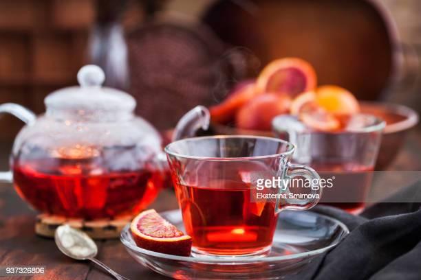 red hot hibiscus tea in glass mug - 温かいお茶 ストックフォトと画像