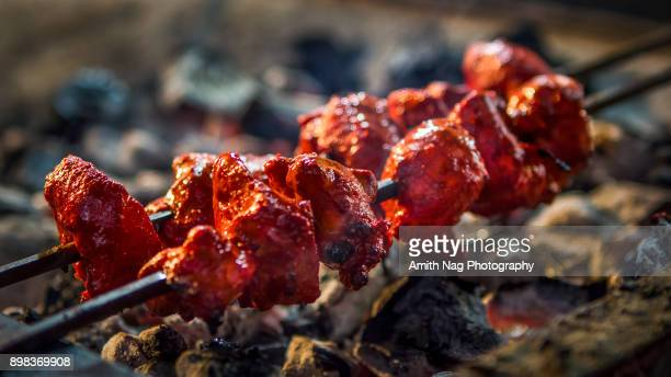 red hot kababs - chicken masala stock photos and pictures
