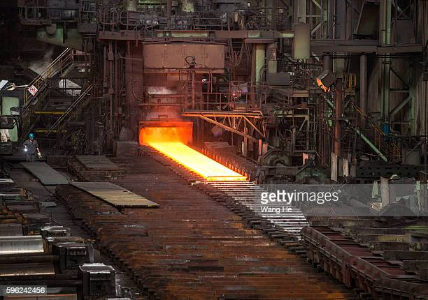 Red hot rolled steel is seen on the production line at the Wuhan Iron Steel Group Corp on August 27 in Wuhan China The two of China's biggest steel...