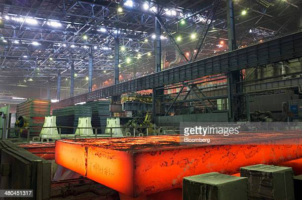 A red hot slab of steel moves along the production line during manufacture at the Ilyich Iron Steel Works of Mariupol OJSC operated by Metinvest...