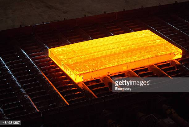 A red hot slab of steel rolls along the production line during the manufacture of seamless pipe sections in the sheet mill at the Vyksa Steel Works...