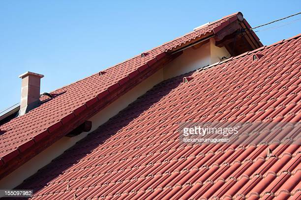 A red house roof on a sunny day
