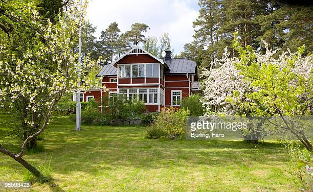 A red house with a garden, Sweden.