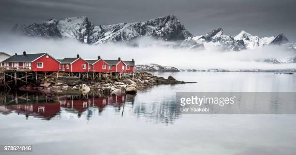 Red houses on rocky coast, Hamny, Norway