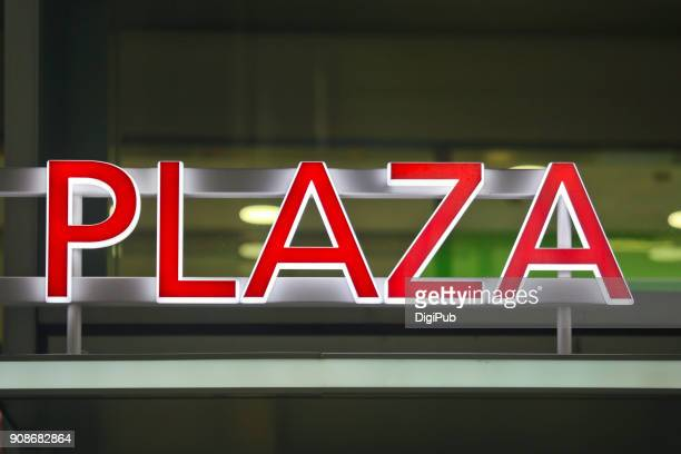 "Red illuminated sign ""PLAZA"""