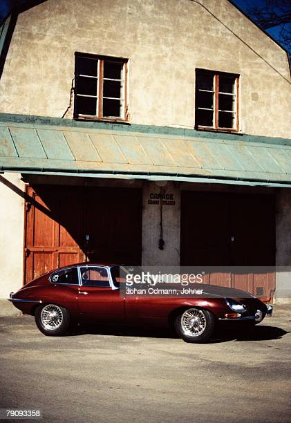 a red jaguar e-type 4.2. - jaguar e type stock photos and pictures