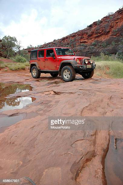 red jeep wrangler, 4x4, 4wd, offroad, palm valley, northern territory - jeep wrangler stock photos and pictures