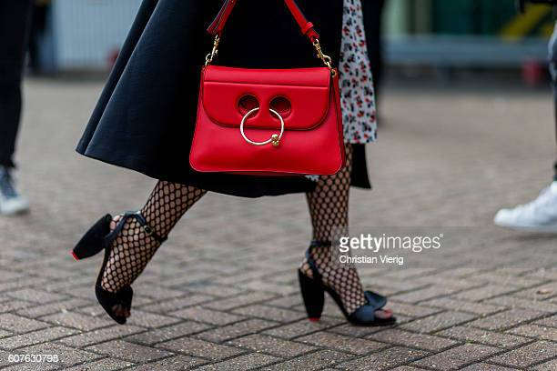 A red JW Anderson bag outside Mulberry during London Fashion Week Spring/Summer collections 2017 on September 18 2016 in London United Kingdom