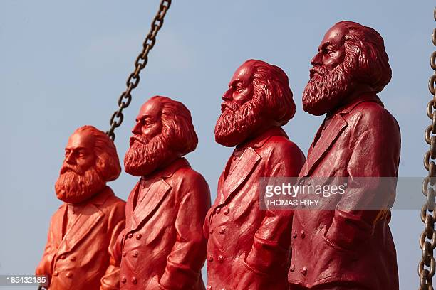 Red Karl Marx sculptures of artist Ottmar Hoerl are pictured at a company in Trier Germany on April 4 2013 The figures will be on display from May...