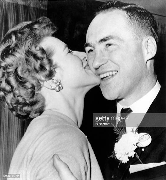 Red Kelly of the Toronto Maple Leafs is kissed by his wife Andra as he was reelected as a Member of Parliament before Game 1 of the 1963 Stanley Cup...