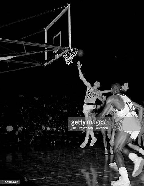 cf49786d6 Red Kerr of the Syracuse Nationals shoots the ball against the Philadelphia  Warriors circa 1962 at