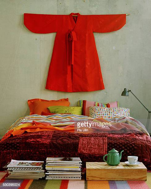 Red kimono over bed