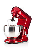Red kitchen stand mixer shot on white backdrop