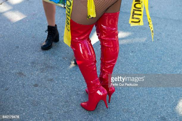 Red Knee High Boots at Venice Beach of California State in USA