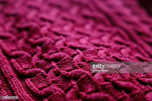 red knitted jumper - clothing stock pictures, royalty-free photos & images