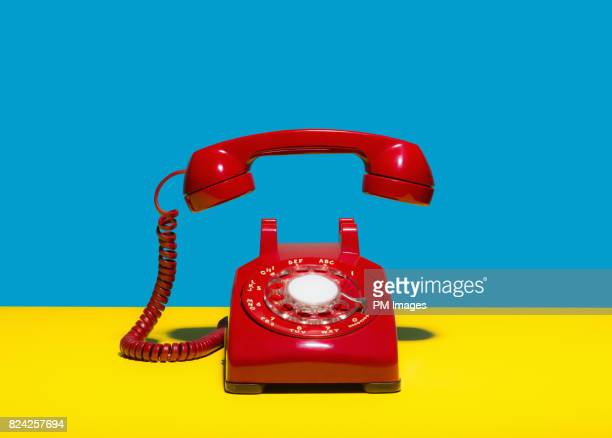 red landline phone - obsolete stock pictures, royalty-free photos & images