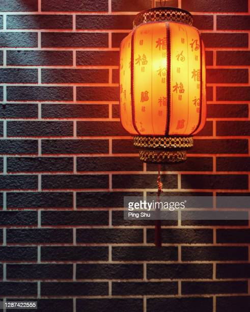 red lanterns and brick walls - beijing stock pictures, royalty-free photos & images