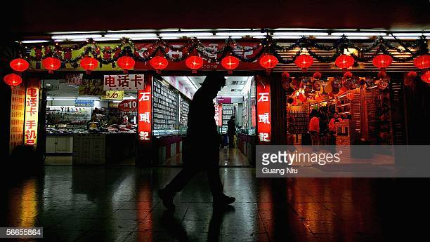 Red lanterns are hung to mark the Chinese New Year on January 24 2006 in Beijing China China will usher in the lunar new year the Year of the Dog on...