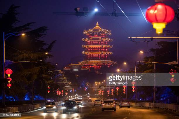 Red lanterns hang on the wire trunks nearby Yellow Crane Tower prior to Spring Festival on January 22, 2021 in Wuhan, Hubei Province,China.The thirty...