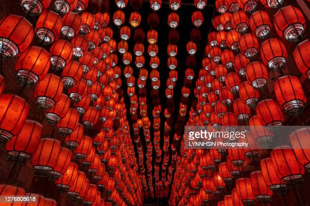 red lanterns hanging on the walls in china mid-autumn festival - lynnhsin stock pictures, royalty-free photos & images